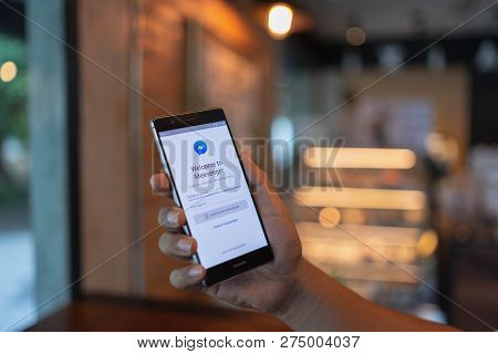 Chiang Mai, Thailand - June 09,2018: Man Hands Holding Huawei With Facebook Messenger App On Screen.
