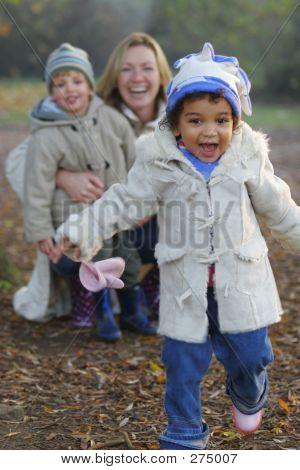 A Beautiful Mixed Race Girl Runs Towards The Camera Laughing Whi