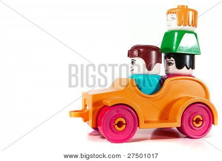 Toy car with an overload of three people driving over white background with lots of copyspace. The car has slight shadows to show the depth.