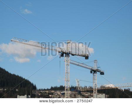 Cranes And Blue Sky