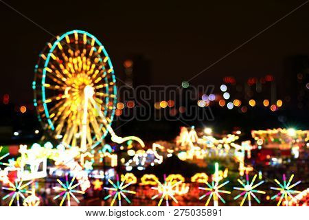 Blur Colors Light Beam Of Fluorescent Light Colorful In Ferris Wheel Festival Temple Fair Night Back