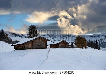 Small cottage in Dolomite mountains in Alpe di Siusil, Italy in winter