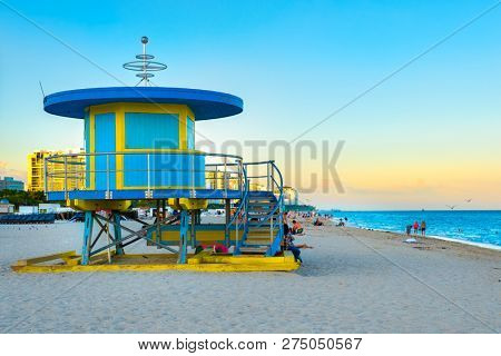 MIAMI BEACH,UNITED STATES - DECEMBER 3,2018 : South Beach near sunset with one of its iconic lifeguard towers