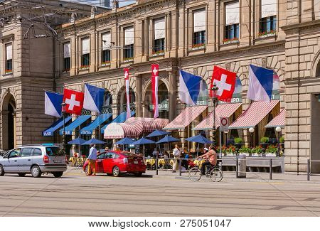 Zurich, Switzerland - May 25, 2016: Part Of The Facade Of The Zurich Main Station, People In Front O