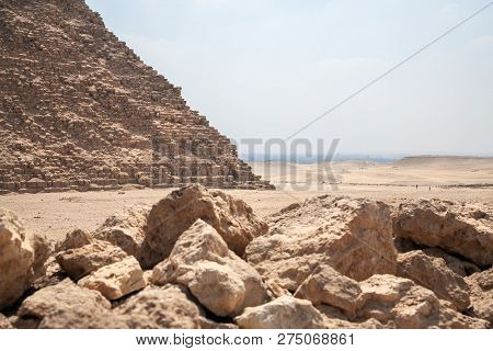 Parth Of Pyramid Cheops In Giza Plato With Many Stones On Foreground And View Desert And Cairo, Capi