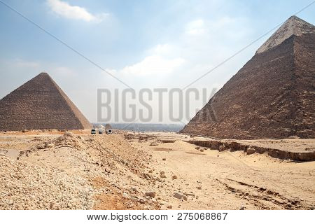 Pyramids Of Giza - Chephren And Cheops Back Side And Background View On Cairo, The Capital Of Egypt