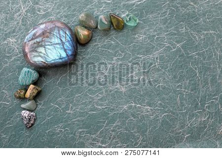 Healing Labradorite And Green Crystal Selection Background - Arranged In The Left Corner Providing C