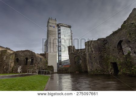 Editorial Swansea, Uk - December 20, 2018: The Ruins Of Swansea Castle And The Modern British Teleco