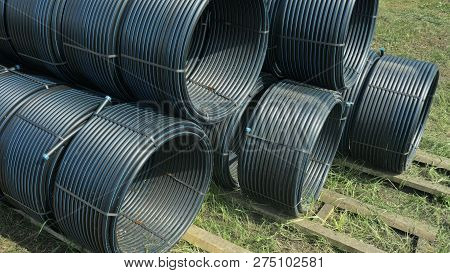 Warehouse Of Finished Plastic Pipes Industrial Outdoors Storage Site. Manufacture Of Plastic Water P