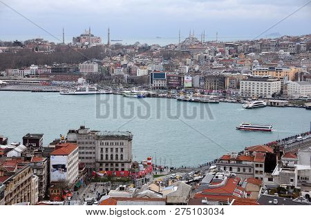 Istanbul, Turkey - January 14, 2018: View Of Golden Horn And Hagia Sophia And Sultanahmet Mosques In