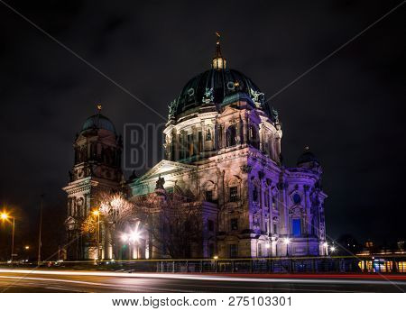 Illuminated Neo-Renaissance Berlin Cathedral (Berliner Dom) or Evangelical Supreme Parish and Collegiate Church at night on Museum Island in the Mitte borough of Central Berlin, Germany poster