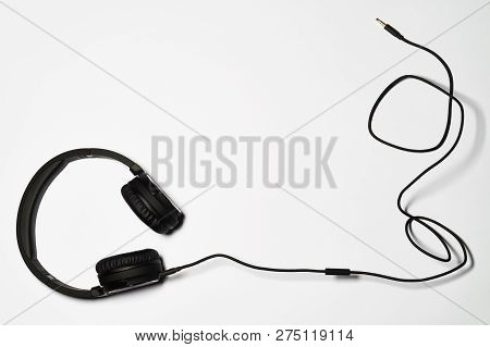 Audio Headphones And Cord On White Background
