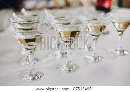 Christmas And New Year Feast. Martini Row On Table Party At Wedding Reception. Martini Drinks In Cry