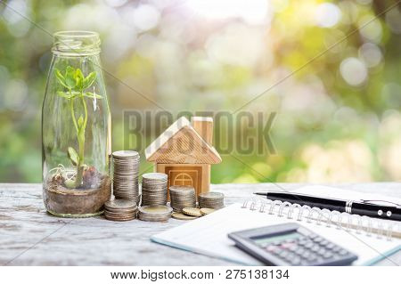 Savings Plan To Invest In Real Estate With Simulated Houses And Coins. Concept For Property Ladder,
