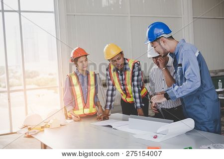 Engineers Are Meeting And Pointing To New Construction Sites, Engineering Tools And Construction Con