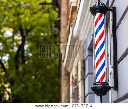 Barber Shop Pole. Logo Of The Barbershop, Symbol. Barbershop Pole, Retro. Copy Space. Old Fashioned