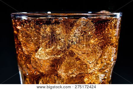 Glass With Soft Cola Drink, Ice And Bubles