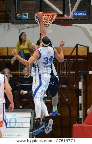 KAPOSVAR, HUNGARY - DECEMBER 10: Michael Fey (34) in action at a Hungarian Championship basketball game Kaposvar (white) vs. Szeged (blue) on December 10, 2011 in Kaposvar, Hungary.