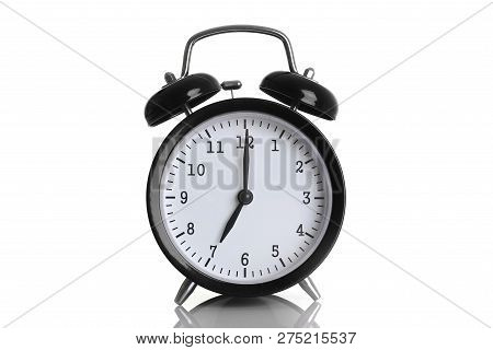 Black Alarm Clock Isolated On White Background Shows Seven O Clock In The Morning Time To Get Up To