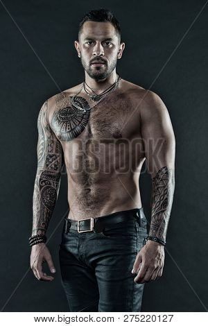 Masculinity And Brutality. Tattoo Culture Concept. Tattoo Brutal Attribute. Man Brutal Unshaven Hisp