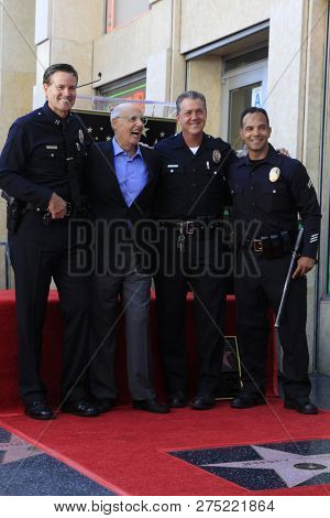 LOS ANGELES - AUG 8:  Jeffrey Tambor, LAPD officers at the Jeffrey Tambor Star Ceremony on the Hollywood Walk of Fame on August 8, 2017 in Los Angeles, CA