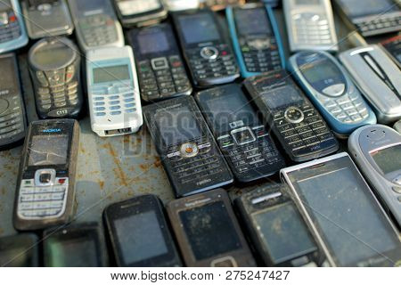 ST. PETERSBURG, RUSSIA - NOVEMBER 4, 2018: Old used mobile phones on the flea market near Udelnaya station. It's the most famous flea market of the city