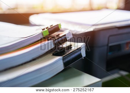 Business Documents Concept : Paperwork Stacks Paper Files Or Unfinished Document Achieves With Clip