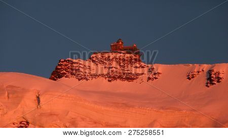 View Of The Mountain Landscape Below The Famous Jungfraujoch In The Swiss Alps Barthed In Red Alpeng