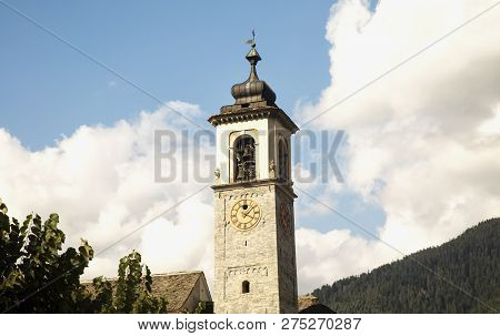 Clocktower With Mountains And Clouds