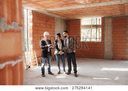 Realtor Showing New Home To Happy Married Couple