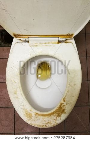 Dirty Smelly Toilet Bowl With Stain And Limescale