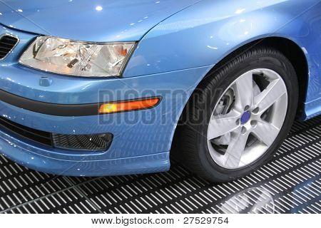 Head lamp of blue saab car