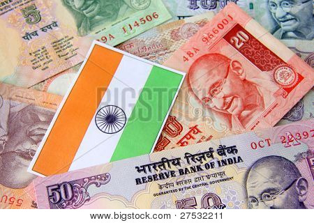 Indian flag and Indian currency concept of growing economy