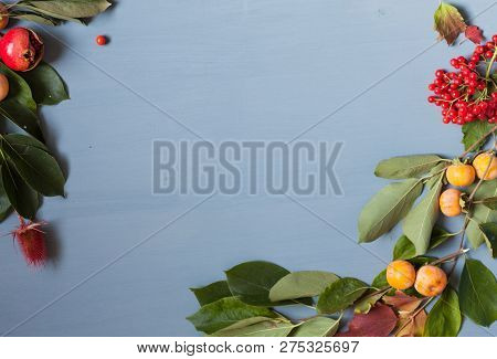 Decor From Fruits And Leaves On A Background Of Breakfast