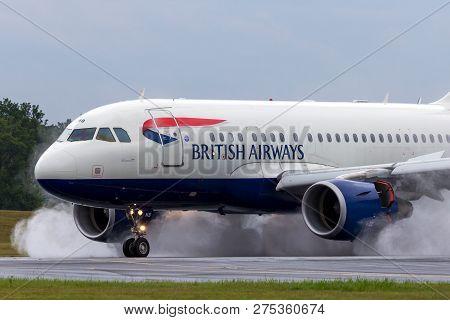 Farnborough, Uk - July 19, 2014: British Airways Airbus A318-112 Aircraft G-eunb Landing On The Wet
