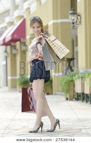 Young Asian Woman Shopping with Bag