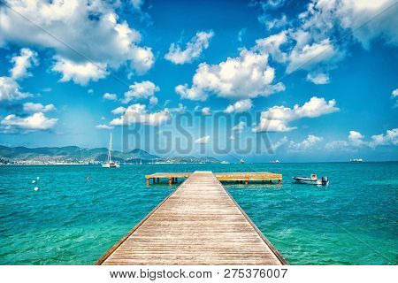 Pier In Turquoise Sea And Blue Sky With White Clouds In Philipsburg, Sint Maarten. Freedom, Perspect