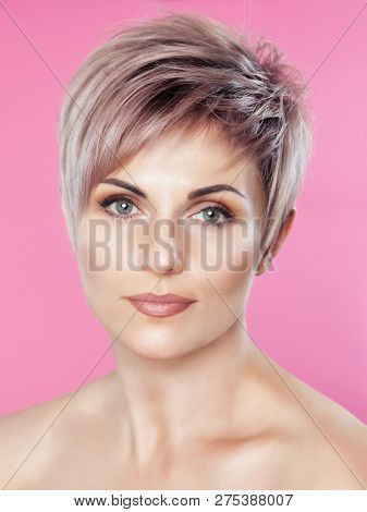 Portrait Of A Beautiful Blonde Woman With Beautiful Make-up And Short Haircut After Dyeing Hair In A