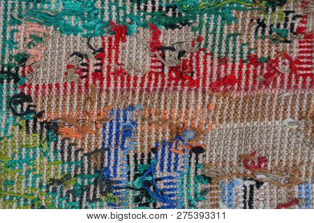 Colored Fabric Background From Embroidered Threads On A Piece Of Old Clothes