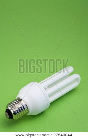 energy saving lamp on green background with copy space