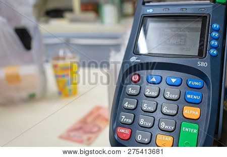 Bangkok, Thailand - December 23: Pos Counter Top Payment Terminal By Pax In Operation In Local 7-ele