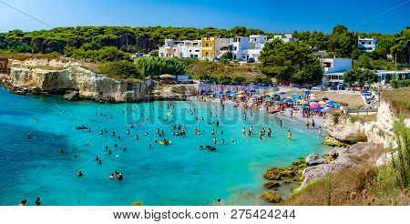 Salento, Lecce, Italy - August 12, 2018: People In Summer Holiday On The Beach In Salento, Enjoying