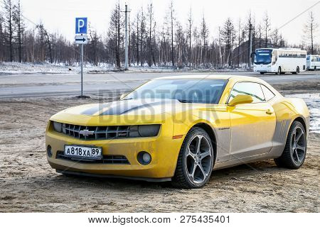 Novyy Urengoy, Russia - May 19, 2018: Dirty Muscle Car Chevrolet Camaro In The City Street.
