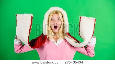 Girl Cheerful Blonde Warming Up Wear Fur Hood On Green Background. Winter Time For Cozy Warm Accesso