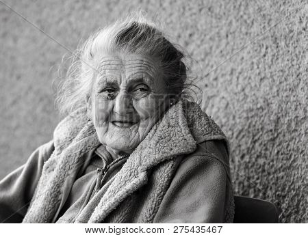 Very Old And Tired Wrinkled Woman Outdoors