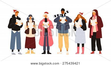Choir Or Group Of Cute Men And Woman Dressed In Outerwear Singing Christmas Carol, Song Or Hymn. Smi