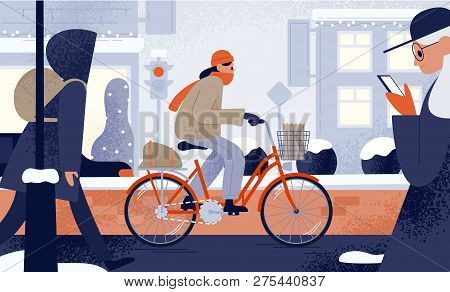 Cute Young Woman Dressed In Outerwear Riding Bicycle In Winter. Girl Cycling Along Snowy City Street