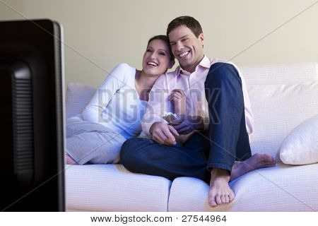 Relaxed couple watching TV, selective focus