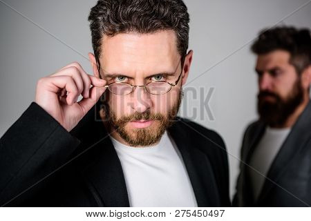 Smart glance. Accessory for smart appearance. Wearing glasses may really mean you are smarter. Man handsome bearded mature guy wear eyeglasses. Eye health and sight. Optics and vision concept poster