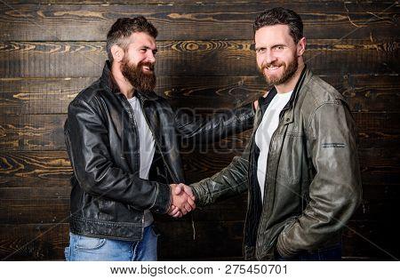 Brutal Bearded Men Wear Leather Jackets Shaking Hands. Real Men And Brotherhood. Strong Handshake. F